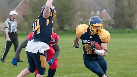Colchester Gladiators' Adam Dickens on his way to a score against Wembley Stallions. Picture: JOHN S