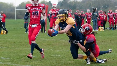 Colchester's Jake Wickham stretches for the goal line but was ruled just short. Picture: JOHN SINGER