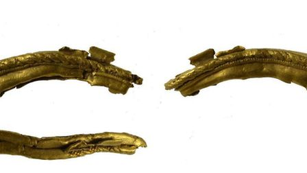 An incomplete gold setting, which could be a stud or a pendant, found near Woodbridge. Archaeologist