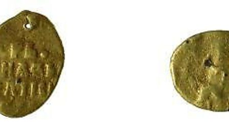 A Russian coin found near Woodbridge. Experts believe this dates to the 17th Century. Picture: SUFFO