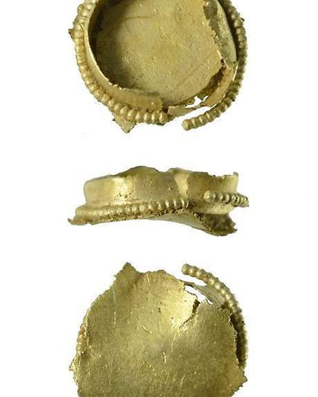 Metal detectors found this incomplete, circular gold setting which is thought to date back to the 7t