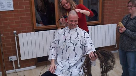 Mark Trewartha while he has having his head shaved for Macmillan Cancer Support. Picture: MEGAN GRAH
