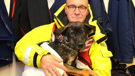 Willow, the lucky dog, pictured with hero Nigel Lyman. Picture: LOWESTOFT RNLI