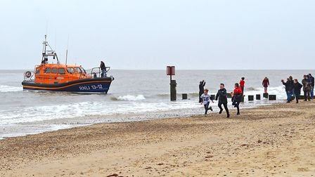 Crowds lining the beach cheered as the lifeboat crew brought Willow safely to shore. Picture: LOWEST
