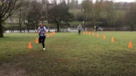 Runners on the short climb up to the finish of the Stevenage parkrun, between the orange cones. Pict