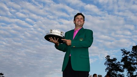 Patrick Reed holds the championship trophy after winning the 2018 Masters in Augusta, Ga. (AP Photo/