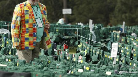 A fan looks for his chair on the 18th hole during the fourth round at the Masters, in Augusta, Ga. (