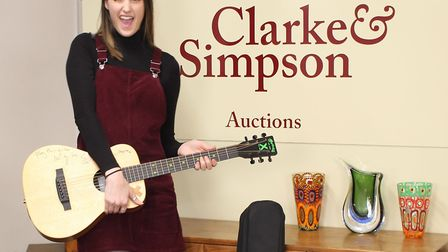 Belle Rogers of Clarke & Simpson with the Ed Sheeran guitar before the auction. Picture: JAMES SHAND