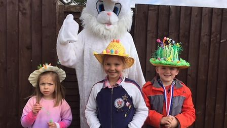 The Easter Bunny meets Margot Durrant, Darcy Durrant and Jamie Baldwin. Picture: POLLY DURRANT