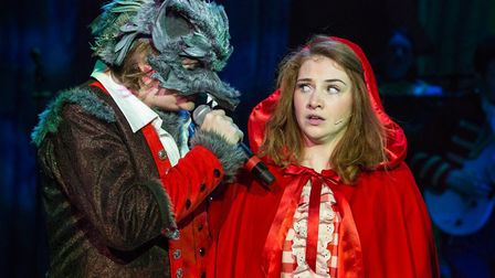 Rob Falconer as The Wolf and Lucy Wells as Red Riding Hood. Red Riding Hood at the New Wolsey Theatr