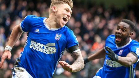Martyn Waghorn is chased by Mustapha Carayol after putting Ipswich Town 2-1 up against Millwall. Pho