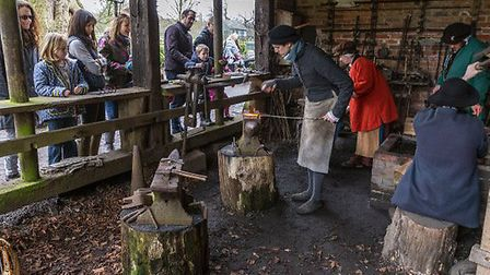 Visitors enjoyed the Tudor recreation event at Kentwell Hall despite the weather. Picture: KENTWELL