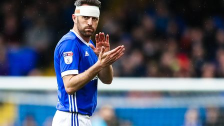 Cole Skuse applauds the fans as he leaves the pitch with his head bandaged, after an injury in the I