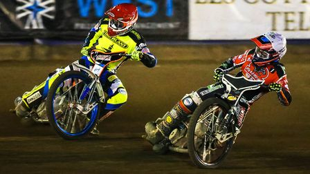 Scott Nicholls makes an inside move on Ipswich's Rory Schlein in heat 15 to help clinch the meeting
