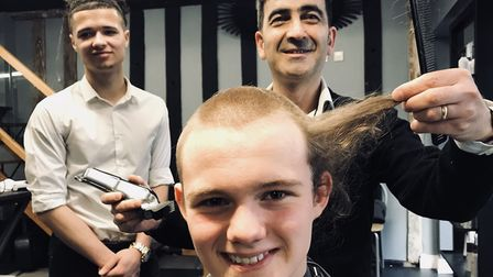 Stanley during his hair cut at Capelli's in Ipswich. Picture: GILLIAN ALLARD
