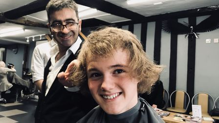 Stanley's hair before he braved the shave with hairdresser Mario who has cut his hair since he was a