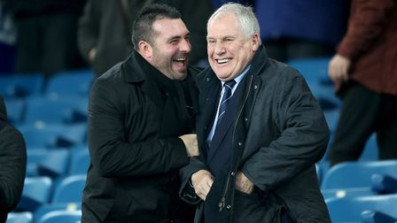 David Unsworth shares a joke with Everton legend and former Town boss Joe Royle in the stands at Goo