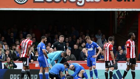 The Ipswich medical team work on an injured Luke Chambers at Brentford Picture Pagepix