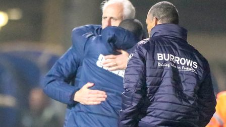 Former Town manager Mick McCarthy and his assistant Terry Connor hug at the final whistle of the Ips