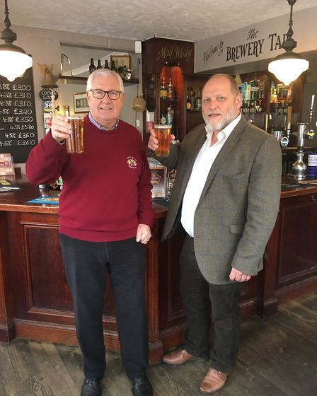 Pictured raising a toast to Simon of Sudbury with the new Bishop's Head beer is Steve Sims, owner of