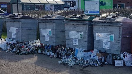 Over-flowing glass recycling bin in the village hall car park in Wickham Market. Picture: IAN OXBURY