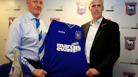 Mick McCarthy holds an Ipswich Town shirt with Chief Executive Simon Clegg (left) is unveiled during