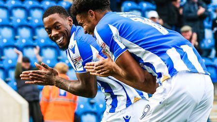 Ryan Jackson, left, celebrates with goalscorer Mikael Mandron during the 3-1 home win over Crewe, la
