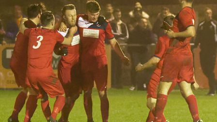 Woodbridge Town players celebrate after Ryan Keeble (third from left) put them into the lead against
