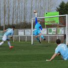 Felixstowe's Callum Bennett (10) sees his shot tipped over the bar by Ely's Harry Reynolds during la