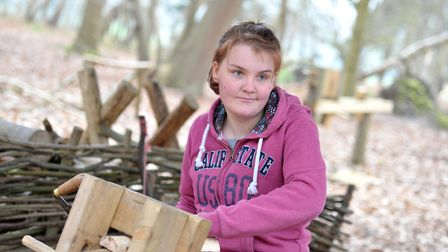 Participant Michaela Cable does some woodwork with the Green Light Trust in Castan Wood, Martlesham.