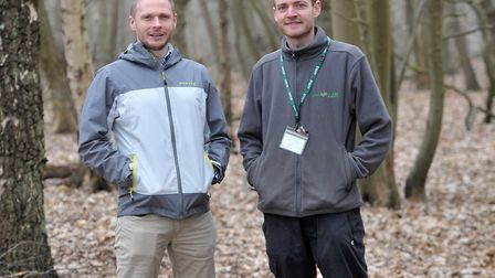 Green Light Trust officers Tom Brown, left, and Jack Pynn in the woodland at Martlesham. Picture: S