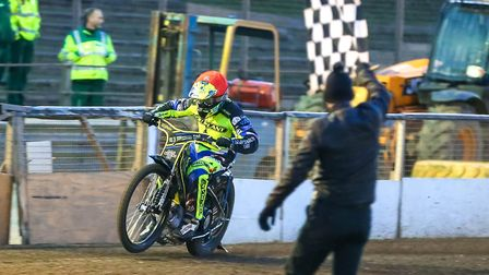 Danny King takes the chequered flag to win heat one on opening night against Peterborough. Pictur