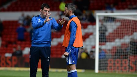 Gerard Nash speaks to Cole Skuse before the match at Nottingham Forest Picture Pagepix