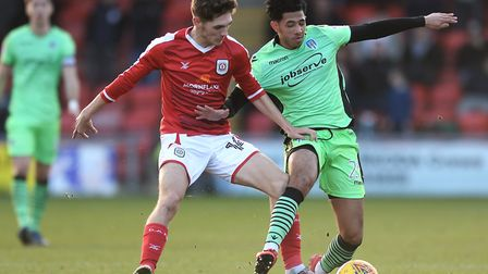 Courtney Senior, right, battles with Crewe's Callum Ainley during the match at Gresty Road in Februa