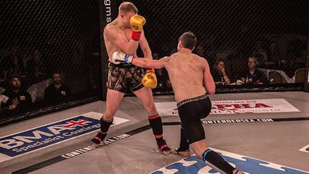 Dean Pattinson, right, lands his trademark southpaw left cross on his opponent at Contenders 18. Pic
