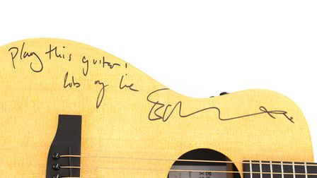 A signed guitar by Suffolk pop music star is being auctioned, by Clarke & Simpson, on Monday April 9