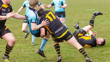 Angus Clogg gets clattered by a Southwold tackle. Photo: SIMON BALLARD
