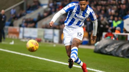 Cole Kpekawa, delivering a cross during the New Year's Day match against Cambridge United. Picture: