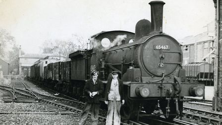 Ellis' Grandad, Ray Moore, with a friend in front of one of the steam engines he drove
