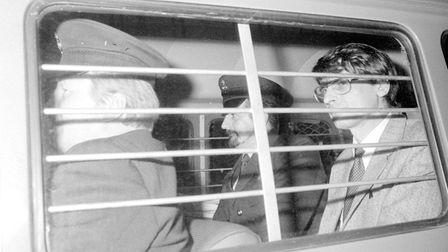 Murderer Dennis Nilsen (right), with a prison warden at his side, after he was sentenced to a minimu