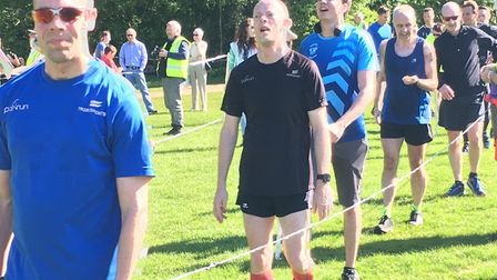 Exhausted runners at the finish to last Saturday's Frimley Lodge parkrun, held in warm conditions. P