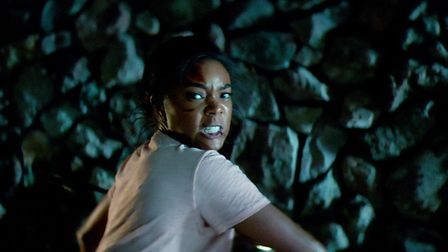 """Mom Shaun (Gabrielle Union) in the film, """"Breaking In."""" Picture: PAUL SARKIS/UNIVERSAL PICTURES"""