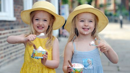 Sunny weather on Angel Hill in Bury St Edmunds. Grace King and Eve King enjoy an ice-cream. Library