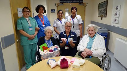 Nancy and Doreen with their knitted creations. Picture: HEALTHCARE HOMES