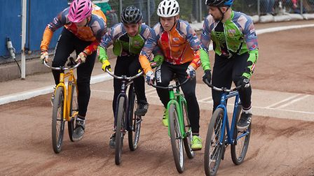 The South West riders, Connor Tucker and Fraser Garnett try to trap the East's Ashley Hill, Lewis Os
