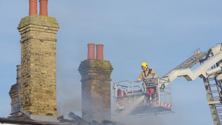 Firefighters tackling the blaze at Saxmundham train station. Picture: SARAH LUCY BROWN