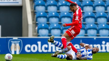 Ryan Jackson, sliding in with this challenge on Swindon's Keshi Anderson during the U's last home ga