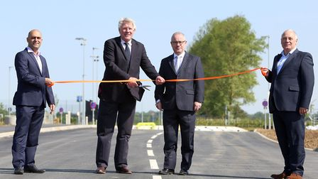 The official opening of the new road at Suffolk Park. Left to right: Jason Newman, John Griffiths, B