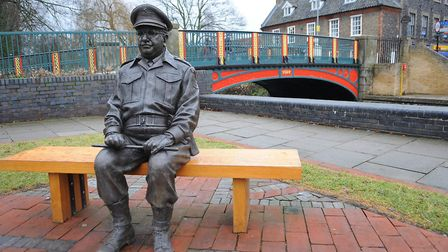 The Thetford Dad's Army Museum's Captain Mainwaring statue, situated between the Anchor Hotel, which
