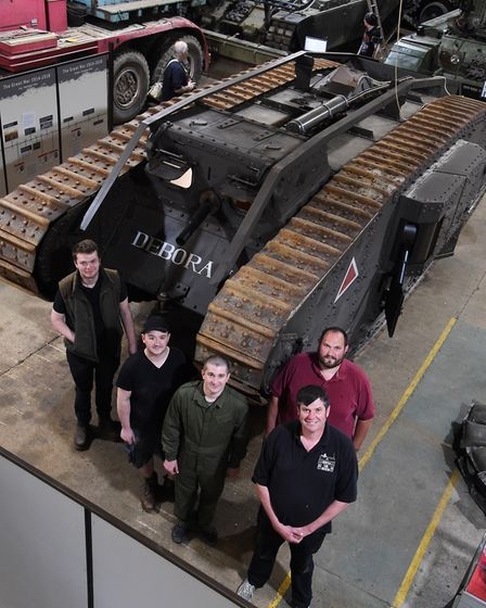 Chairman of the Norfolk Tank Museum at Forncett St Peter, Stephen MacHaye, front right, with volunte